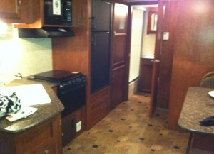 Minnie's galley with bathroom at the end and bunks behind wall on right